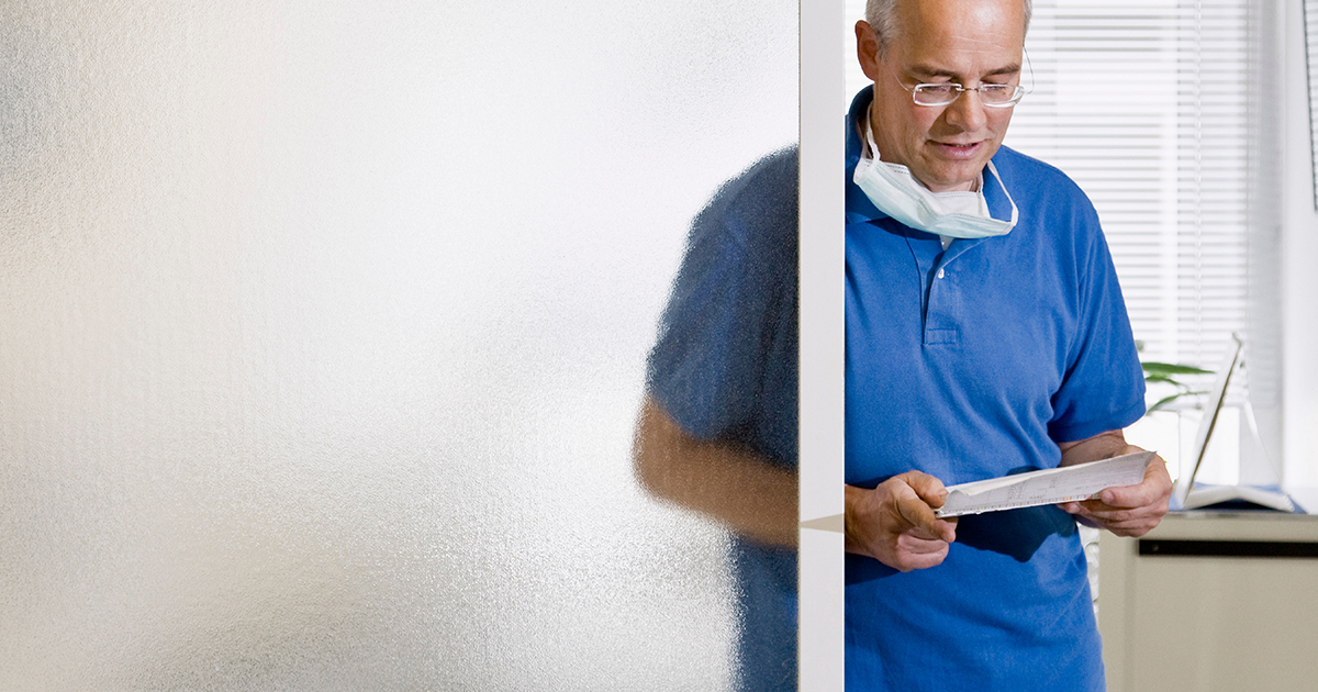 Dentist looking at a chart in a dental office
