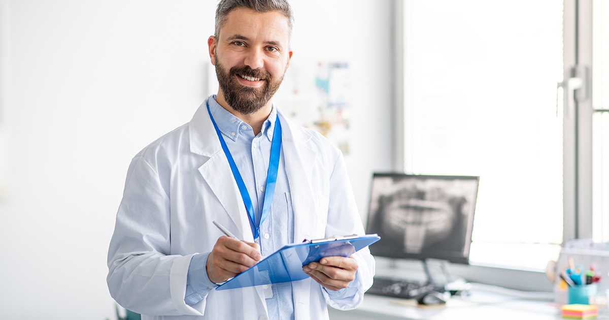 Dentist holding up a chart